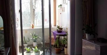 Раздвижные пластиковые двери на балкон